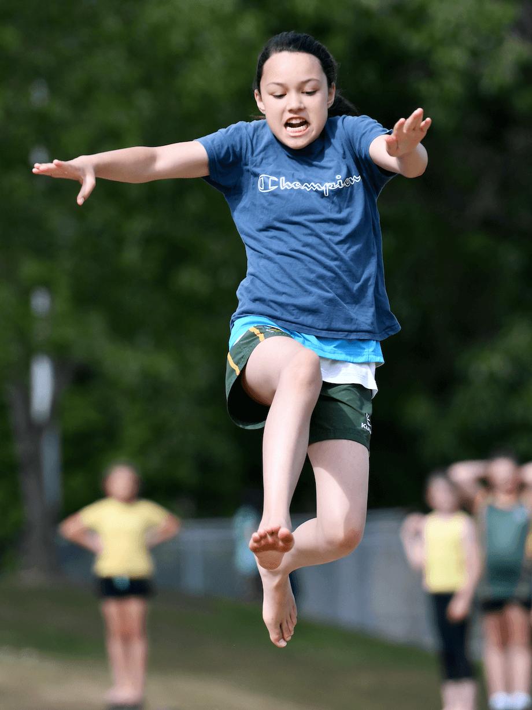 Female doing long jump