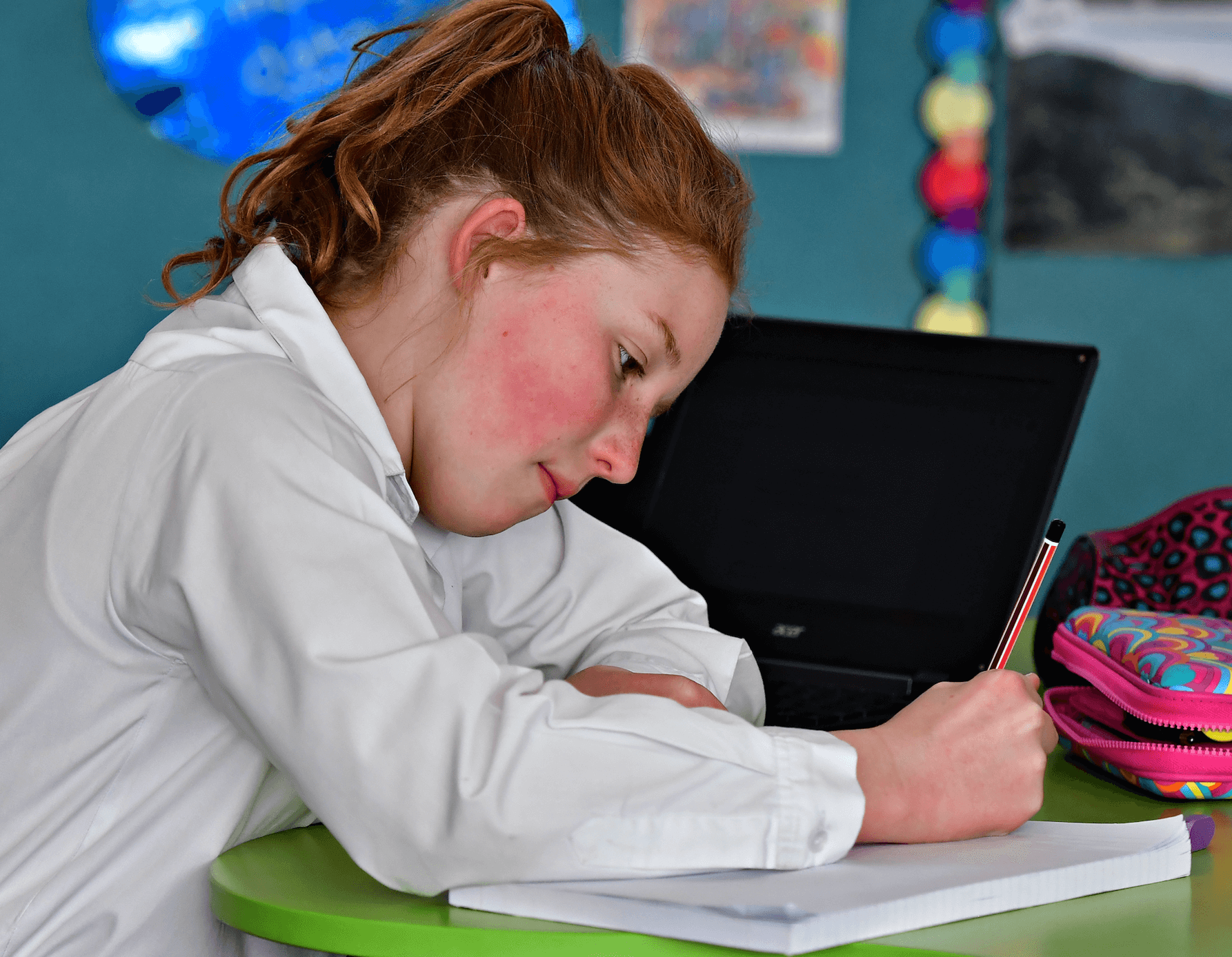 Female student writing in a notebook