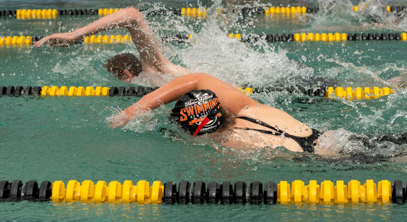 Girls swimming in an olympic pool